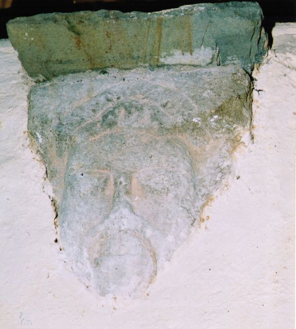 Carved stone head over the west door of Ross Cathedral – reputedly of St. Fachtna.